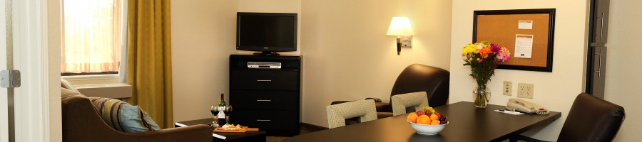 Cozy modern style Candlewood Suites hotel room with free wifi and spa services